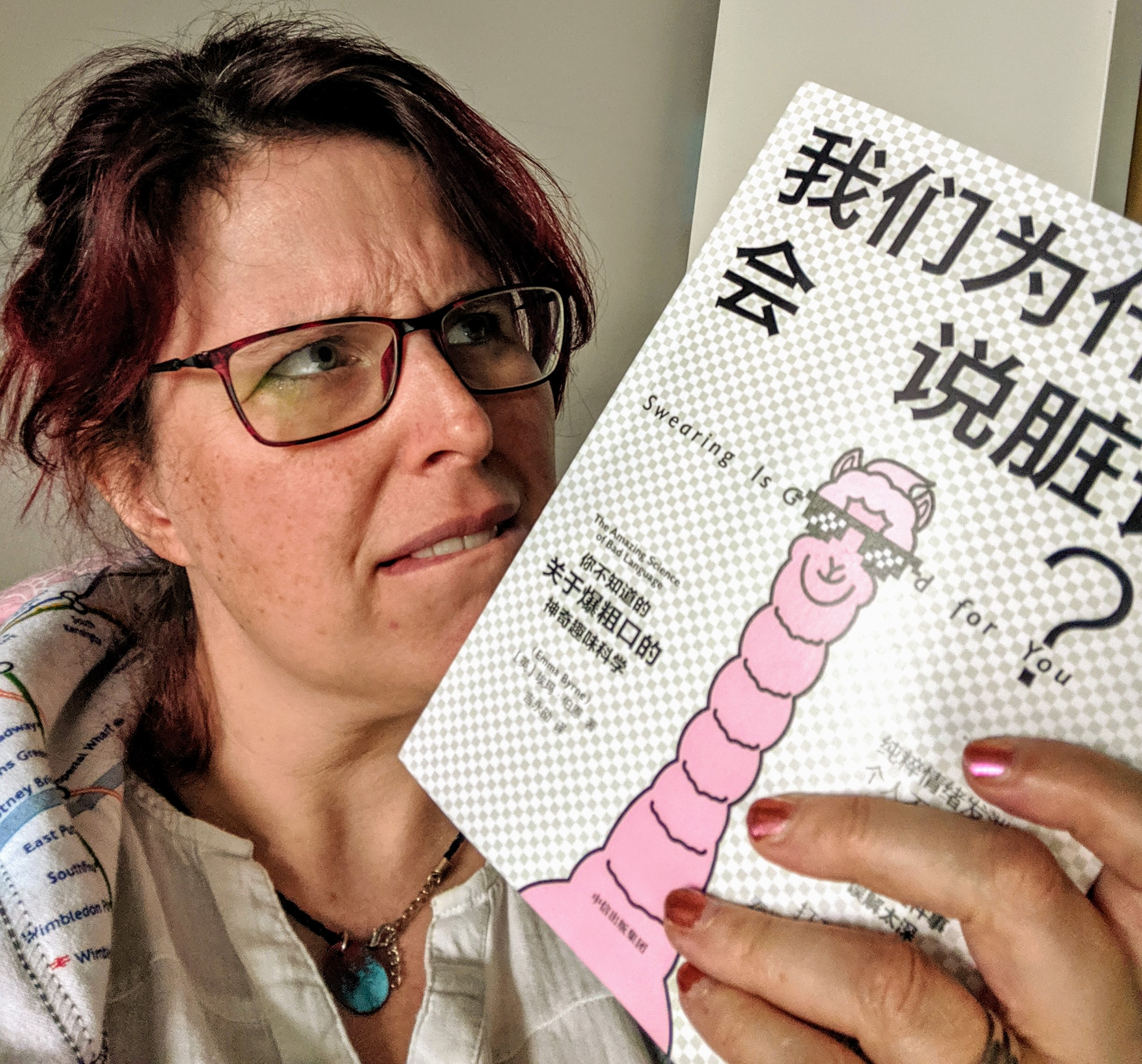 Picture of Emma holding the chinese edition of Swearing is Good for You